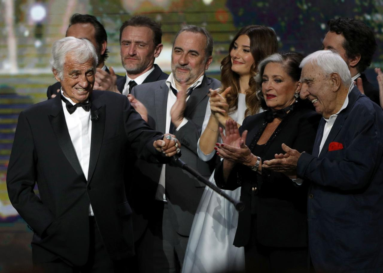 Actor Jean-Paul Belmondo (L) reacts on stage as he receives an Honorary Cesar Award at the 42nd Cesar Awards ceremony in Paris, France, February 24, 2017.       REUTERS/Philippe Wojazer