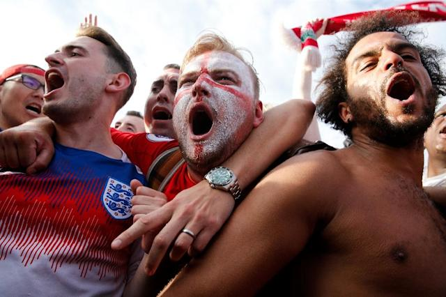 England fans celebrate after their team beat Sweden in the World Cup quarter-finals (AFP Photo/Maxim ZMEYEV)