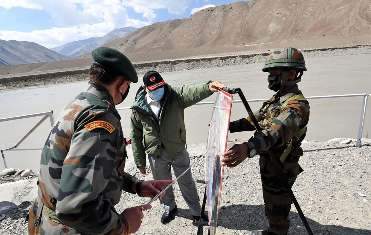 In this handout photo provided by the Press Information Bureau, Indian Prime Minister Narendra Modi interacts with soldiers during a visit to the Ladakh area. (Press Information Bureau via AP)