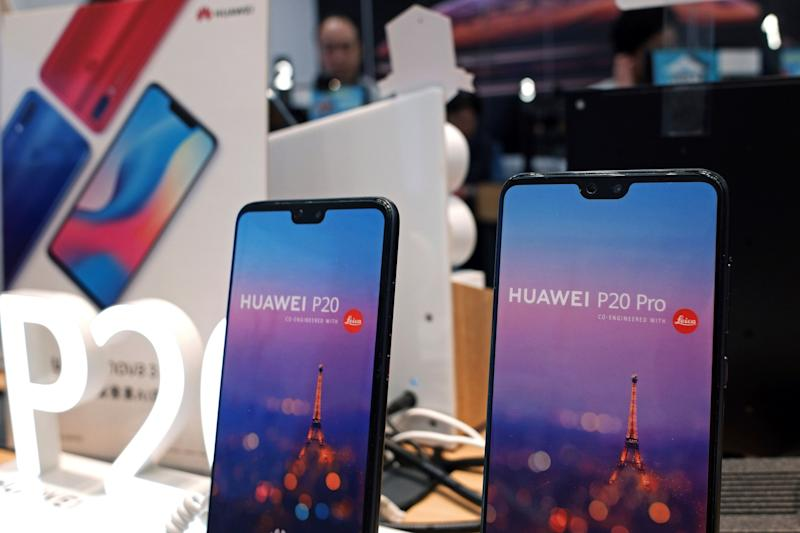 Huawei's mobile phones are displayed at a telecoms service shop in Hong Kong, Friday, March 29, 2019. Chinese tech giant Huawei's deputy chairman defended its commitment to security Friday after a stinging British government report added to Western pressure on the company by accusing it of failing to repair dangerous flaws in its telecom technology. (AP Photo/Kin Cheung)