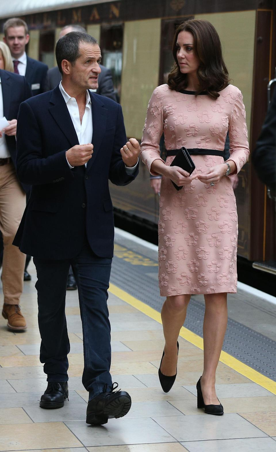 <p>The Duchess made a surprise appearance at Paddington station to meet cast members of 'Paddington 2' as well as 130 children. Kate chose a peach floral number from Orla Kiely's AW13 collection.<br><i>[Photo: PA]</i> </p>