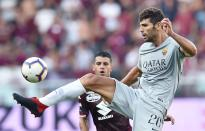 Roma's Federico Fazio reaches for the ball during the Serie A soccer match between Torino and Roma at the Turin Olympic Stadium, Italy, Sunday, Aug. 19, 2018. (Alessandro Di Marco/ANSA via AP)