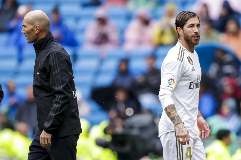 The tactical nous of Zinedine Zidane (left) and an airtight defense led by Sergio Ramos will help Real Madrid in the Champions League. (Photo by David S. Bustamante/Soccrates/Getty Images)