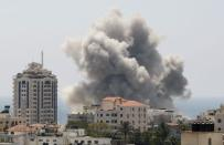 Smoke rises following what witnesses said was an Israeli air strike in Gaza City July 27, 2014. REUTERS/Suhaib Salem