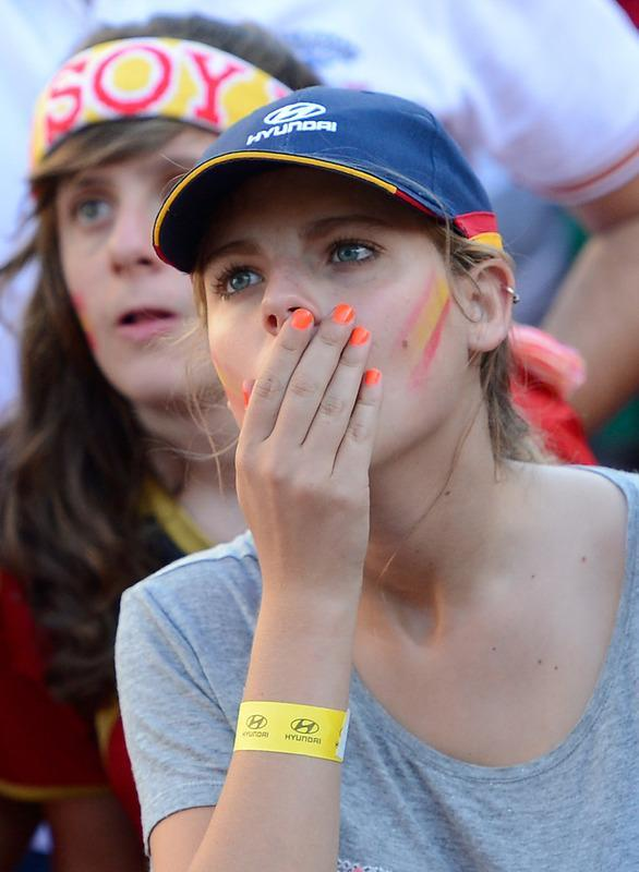 A supporter of the Spanish national football team reacts during the Euro 2012 Championships football match between Spain and Italy on June 10, 2012 near Santiago Bernabeu Stadium in Madrid. Holders Spain were held to a 1-1 draw by a dogged and determined Italy at the Arena Gdansk in the opening Group C match at the European Championship. AFP PHOTO/ DANI POZODANI POZO/AFP/GettyImages