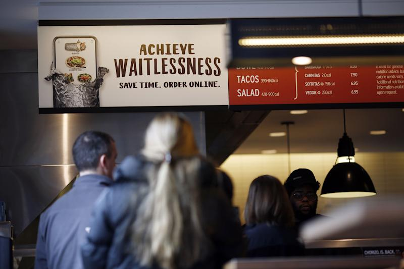 Customers wait in line to order food at a Chipotle Mexican Grill Inc. restaurant in Louisville, Kentucky, U.S., on Saturday, Feb. 2, 2019. Chipotle Mexican Grill Inc. is scheduled to release earnings figures on February 6. Photographer: Luke Sharrett/Bloomberg via Getty Images
