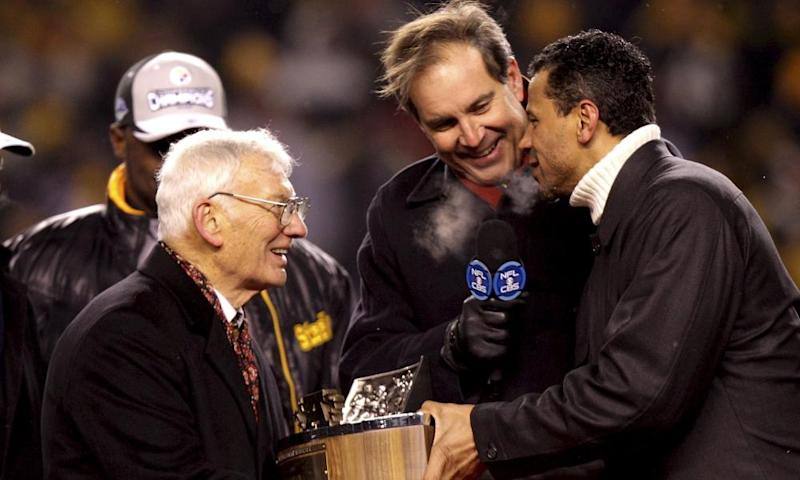 Dan Rooney receives the AFC Championship trophy after the Steelers defeated the Ravens 23-14 in January 2009.