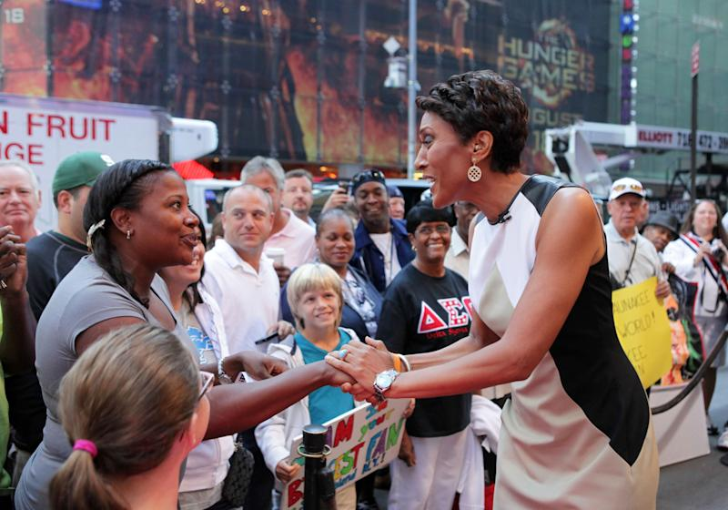 "This image released by ABC shows ""Good Morning America"" co-host Robin Roberts, right, speaking with a fan outside on the popular morning show on Thursday, Aug. 30, 2012 in New York. Roberts has said goodbye to ""Good Morning America,"" but only for a while. The ""GMA"" anchor made her final appearance Thursday before going on medical leave for a bone marrow transplant. Roberts' departure was first planned for Friday, but she chose to exit a day early to visit her ailing mother in Mississippi. In July she first disclosed that she has MDS, a blood and bone marrow disease. She will be hospitalized next week to prepare for the transplant. The donor will be her older sister, Sally-Ann Roberts. (AP Photo/ABC, Fred Lee)"
