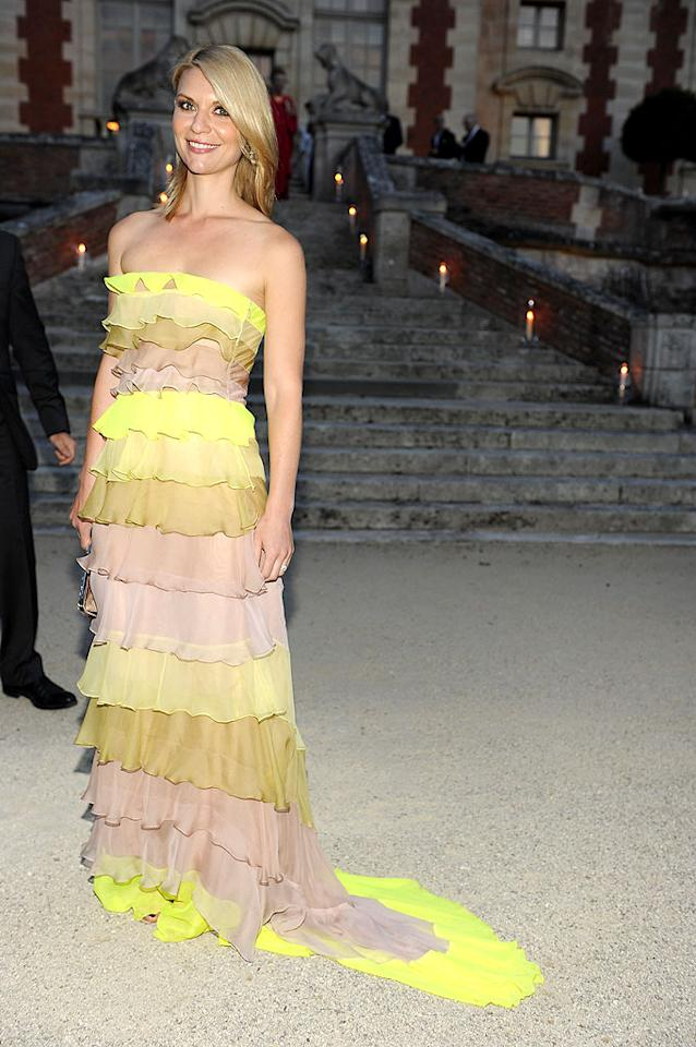 """Neon is typically a no-no, but Claire Danes did the summery trend justice by wearing this strapless nude, taupe, and electric yellow Valentino Spring 2010 Couture gown to a fabulous Paris Fashion Week fete. Kudos to Claire for taking a major risk and having it pay off ... big time! <a href=""""http://www.infdaily.com"""" target=""""new"""">INFDaily.com</a> - July 7, 2010"""