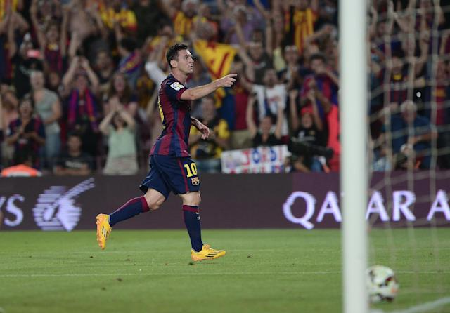 Barcelona's Argentinian forward Lionel Messi celebrates after scoring during the match FC Barcelona vs Elche CF at the Camp Nou stadium in Barcelona on August 24, 2014 (AFP Photo/Josep Lago )