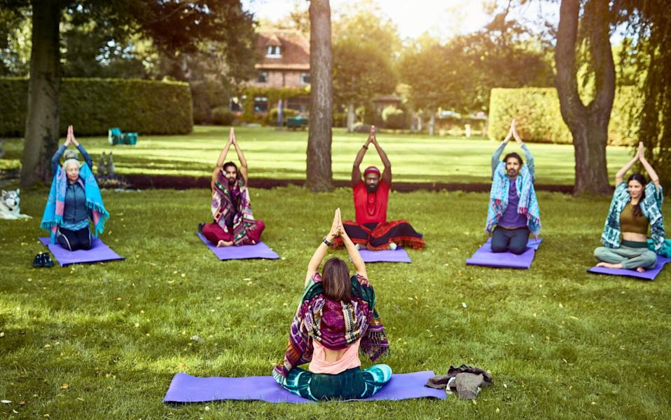 yoga instructor and students - Getty