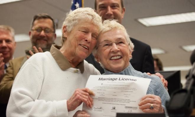 Jane Abbott Lighty (left) and Pete-e Petersen embrace after receiving the first same-sex marriage license in Washington state on Dec. 6.