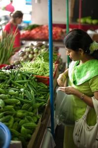 Woman buying vegetables from the market