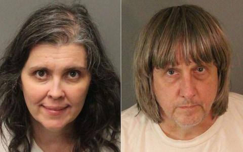Police custody images of David Allen Turpin and Louise Anna Turpin - Credit: JOSE ROMERO /AFP/Getty