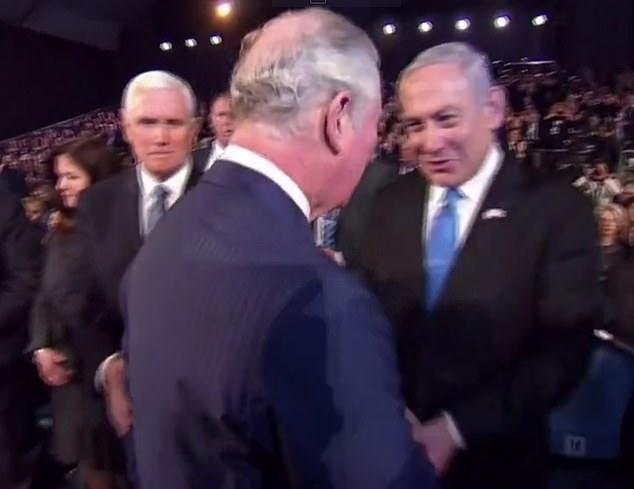 Prince Charles greets Benjamin Netanyahu Mike Pence touches his shoulder on left