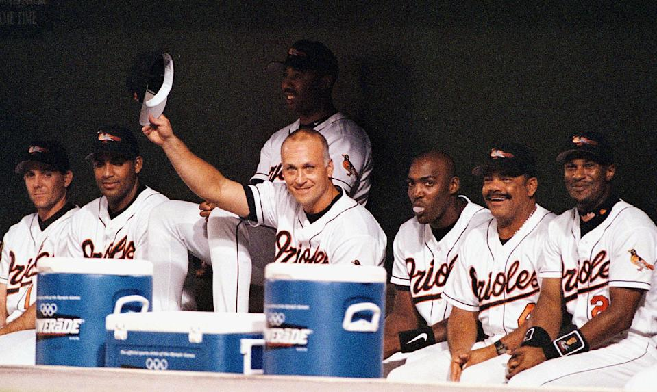 Cal Ripken Jr. tips his cap to the fans at Camden Yards on the night his consecutive games played streak came to an end. (Getty)