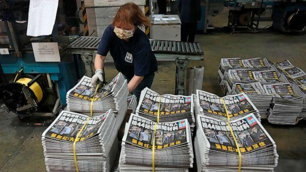 PHOTO: FILE - In this Friday, June 18, 2021, file photo, a worker packs copies of the Apple Daily newspaper at the printing house in Hong Kong.  (Kin Cheung/AP)