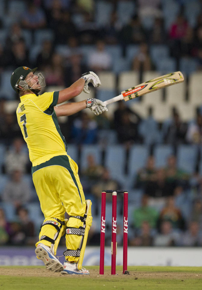 Australia's batsman Cameron White reacts as his shot is midair and caught for 14 runs during their T20 Cricket match against South Africa at Centurion Park in Pretoria, South Africa, Friday, March 14, 2014. (AP Photo/Themba Hadebe)