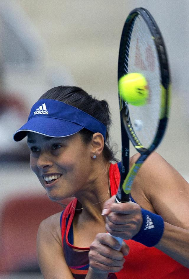 Ana Ivanovic of Serbia returns a shot to Polona Hercog of Slovenia during the China Open tennis tournament at the National Tennis Stadium in Beijing, China Wednesday, Oct. 2, 2013. (AP Photo/Andy Wong)