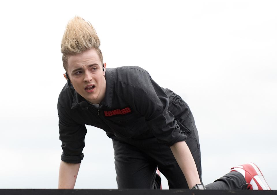 WESTON-SUPER-MARE, ENGLAND - JULY 4:  Edward Grimes of Jedward is injured while performing on the main stage at T4 On The Beach on July 4, 2010 in Weston-super-Mare, England. (Photo by Samir Hussein/Getty Images)