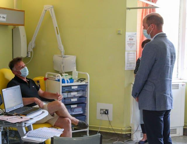 The Duke of Cambridge talks to a patient participating in the Covid-19 vaccine trial last year