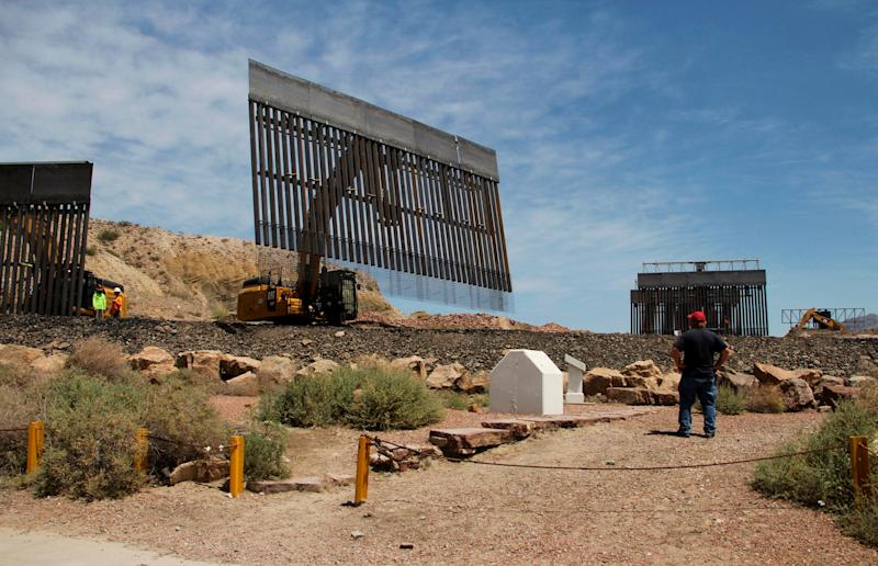 Workers build a border fence in a private property located in the limits of the US States of Texas and New Mexico taken from Ciudad Juarez, Chihuahua state, Mexico on May 26, 2019. (Photo by HERIKA MARTÍNEZ / AFP) (Photo credit should read HERIKA MARTINEZ/AFP/Getty Images)