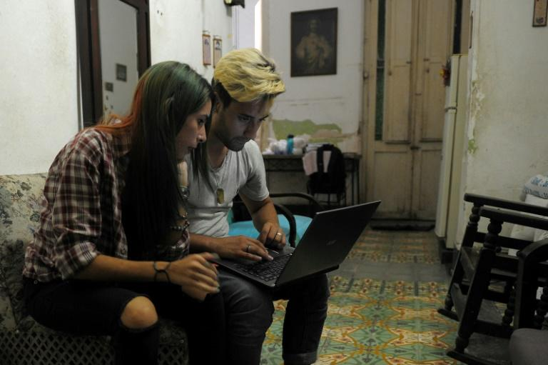 Cuban youtubers prepare videos at home in Havana, but posting them means a trek across town to a public square where there is wifi