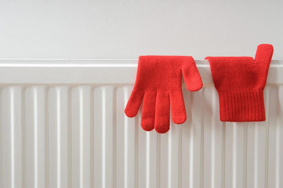 Put tin foil behind your radiators to reflect heat back into the house. [Photo: Getty]