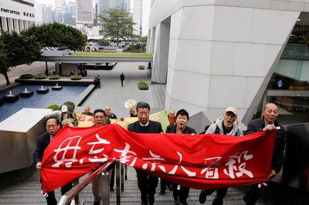 Protesters march to Japan's consulate to commemorate the 80th anniversary of the Nanjing Massacre, in Hong Kong