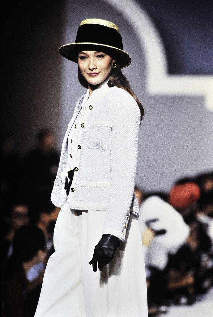 PARIS, FRANCE - OCTOBER 24: Model Carla Bruni-Sarkozy walks the runway during the Chanel Ready to Wear Spring/Summer 1989 show as part of the Paris Fashion Week on October 24, 1988 in Paris,France. (Photo by Victor VIRGILE/Gamma-Rapho via Getty Images)