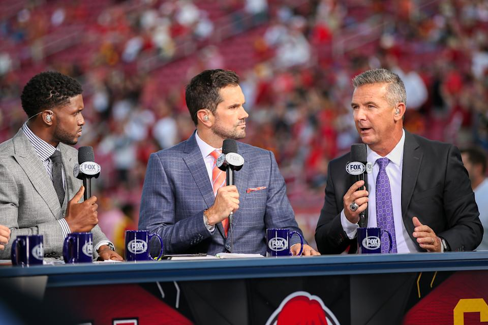 Fox college sports anchors Reggie Bush, Matt Leinart and Urban Meyer after a college football game between the Utah Utes and The USC Trojans on September 20, 2019, at the Los Angeles Memorial Coliseum in Los Angeles, CA. (Photo by Jordon Kelly/Icon Sportswire via Getty Images)