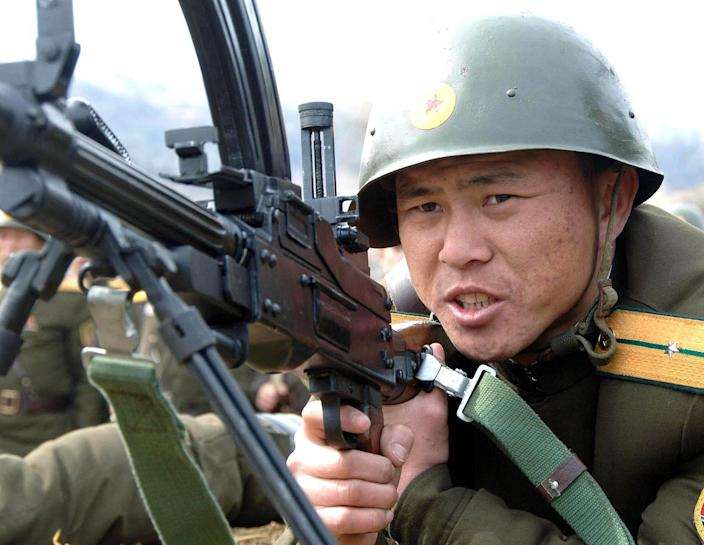 <p>A North Korean soldier of a unit of the Korean People's Internal Security Forces takes a position during a live-fire exercise at an undisclosed place in North Korea, in this March 8, 2012 photo distributed March 10, 2012. (Korean Central News Agency via Korea News Service/AP) </p>