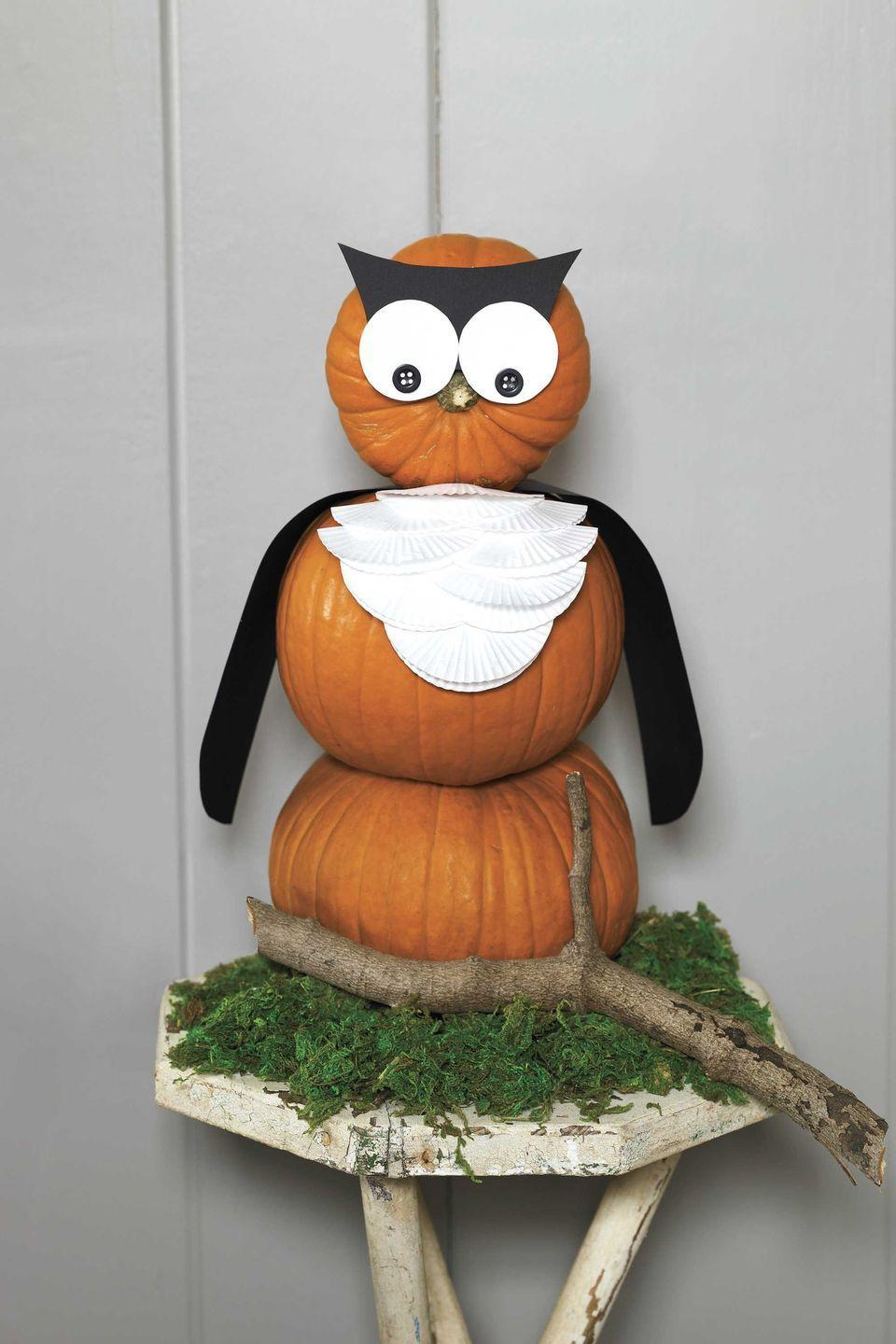 """<p>Whoo's cuter than this guy? Fashion an adorable owl out of a stack of pumpkins, paper and other basic craft supplies.</p><p><strong><em><a href=""""https://www.womansday.com/home/crafts-projects/how-to/a6013/craft-project-night-owl-123882/"""" rel=""""nofollow noopener"""" target=""""_blank"""" data-ylk=""""slk:Get the Night Owl tutorial."""" class=""""link rapid-noclick-resp"""">Get the Night Owl tutorial.</a></em></strong> </p>"""