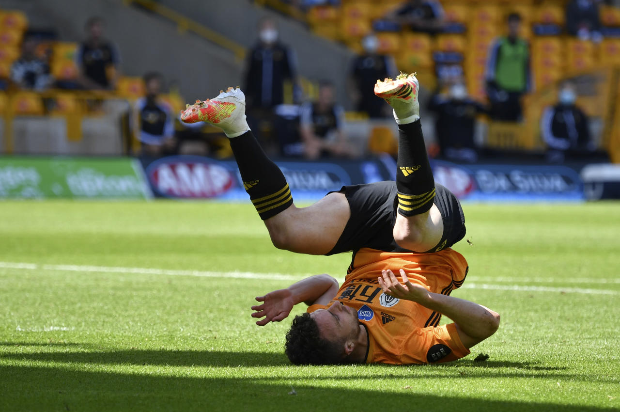 Wolverhampton Wanderers' Diogo Jota during the English Premier League soccer match between Watford and Everton at the Molineux Stadium in Wolverhampton, England, Sunday, July 12, 2020. (Ben Stansall/Pool via AP)