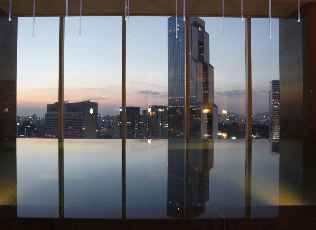 "An indoor swimming pool is seen at the top of a luxury hotel in the Gangnam area of Seoul. Gangnam is the most upmarket neighbourhood in the South Korean capital. Known as Seoul's ""Beverly Hills"", its streets are lined with designer-brand shops and trendy bars and restaurants. Chubby South Korean singer Psy was raised in the area and his hit song ""Gangnam Style"", with his quirky horse-riding dance, has stormed to number one in charts around the world while the video has been watched more than 454 million times on YouTube since July."