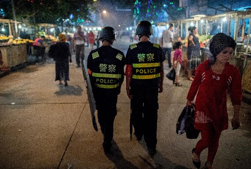 Police patrolling in a night food market near the Id Kah Mosque in Kashgar in China's Xinjiang Uighur Autonomous Region on June 25, 2017, a day before the Eid al-Fitr holiday (AFP Photo/Johannes EISELE)