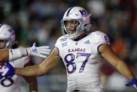 Kansas tight end Jack Luavasa celebrates his touchdown during the first half of an NCAA college football game against Boston College in Boston, Friday, Sept. 13, 2019. (AP Photo/Michael Dwyer)
