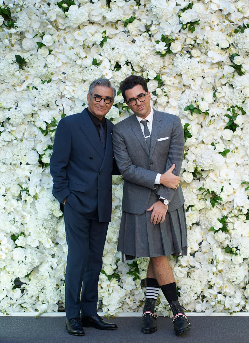 """<h2>Eugene Levy in Dior & Dan Levy in Thom Browne<br></h2>In addition to making us tear up dramatically during <em><a href=""""https://www.refinery29.com/en-us/2020/09/10036865/schitts-creek-emmy-wins-7-awards-comedy-series-record"""" rel=""""nofollow noopener"""" target=""""_blank"""" data-ylk=""""slk:all"""" class=""""link rapid-noclick-resp"""">all</a></em><a href=""""https://www.refinery29.com/en-us/2020/09/10036865/schitts-creek-emmy-wins-7-awards-comedy-series-record"""" rel=""""nofollow noopener"""" target=""""_blank"""" data-ylk=""""slk:of their victory speeches"""" class=""""link rapid-noclick-resp""""> of their victory speeches</a> tonight, Eugene Levy and his son-slash-writing-partner Dan, dressed their absolute best at <em><a href=""""https://www.refinery29.com/en-us/2020/09/10036812/schitts-creek-emmys-party-tent-casa-loma-toronto"""" rel=""""nofollow noopener"""" target=""""_blank"""" data-ylk=""""slk:Schitt's Creek"""" class=""""link rapid-noclick-resp"""">Schitt's Creek</a></em><a href=""""https://www.refinery29.com/en-us/2020/09/10036812/schitts-creek-emmys-party-tent-casa-loma-toronto"""" rel=""""nofollow noopener"""" target=""""_blank"""" data-ylk=""""slk:'s Emmys party"""" class=""""link rapid-noclick-resp"""">'s Emmys party</a>. Eugene in a clashing (in a good way) navy-and-black Dior suit and Dan in a pleated skirt and matching blazer courtesy of Thom Browne."""