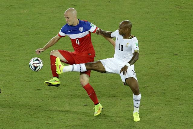 United States' Michael Bradley, left, and Ghana's Andre Ayew challenge for the ball during the group G World Cup soccer match between Ghana and the United States at the Arena das Dunas in Natal, Brazil, Monday, June 16, 2014. (AP Photo/Hassan Ammar)