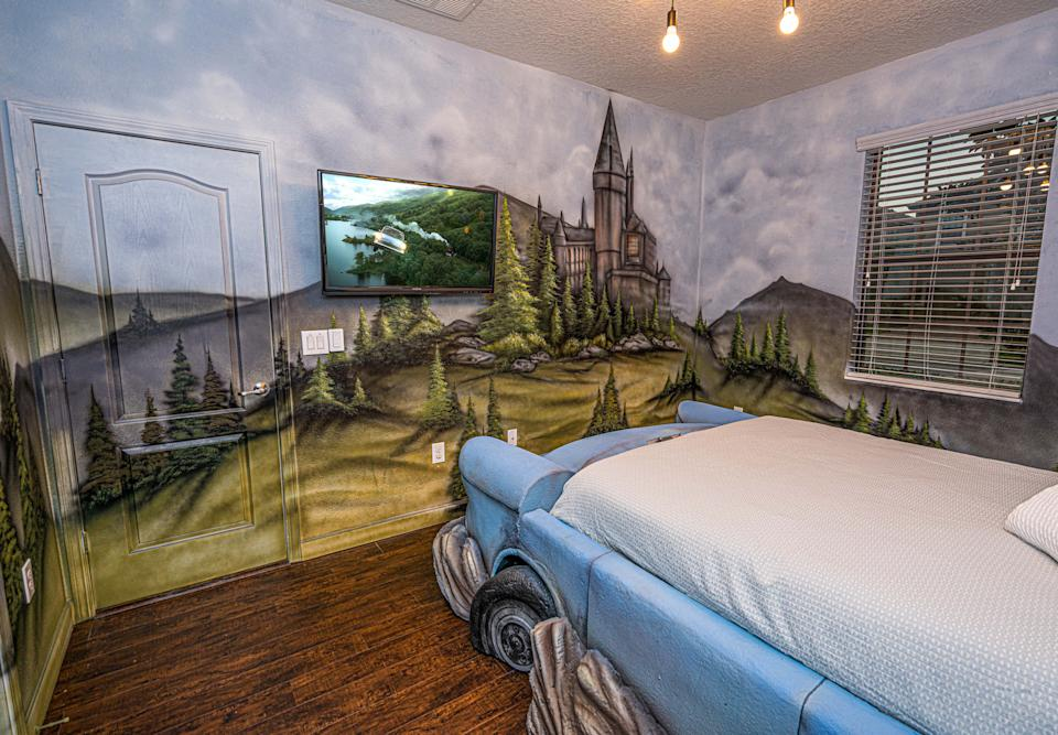 PIC BY @LOMA HOMES / CATERS NEWS AGENCY (PICTURED- A bedroom design to look like Ron Weasley's car stuck in The Whomping Willow Tree ) - Harry Potter fans looking for a first post-lockdown trip can put this place at the top of their list - a night in a Hogwarts- themed Airbnb. The eight-bedroom home, called ' Wizard's Way' is based in Florida, US, near the Universal Orlando Resort. There are rooms based on the four houses Gryffindor, Hufflepuff, Ravenclaw, and Slytherin and each bathroom has its own Harry Potter theme, from Hedwig and the  Ministry of Magic to Dobby, and Sirius Black. One of the bedrooms  features an interactive car-shaped bed which is inspired by the scene where Harry and Ron get stuck in the Willow Tree of the second part of the film series. - SEE CATERS COPY