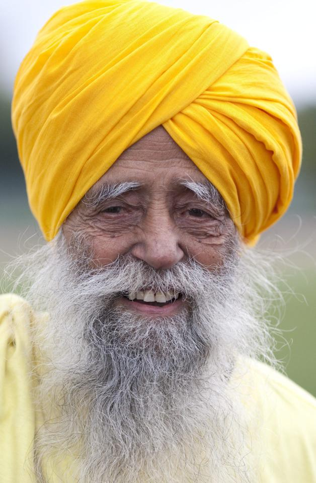 Centenarian Fauja Singh smiles on the track between races in Toronto, Thursday Oct. 13, 2011. One-hundred-year-old Singh, originally from India now living in London, England, is competing in Toronto's Waterfront Marathon on Sunday. (AP Photo/The Canadian Press, Chris Young)