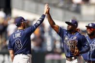 Tampa Bay Rays left fielder Randy Arozarena high-fives second baseman Brandon Lowe (8) after defeating the New York Yankees in a baseball game on Monday, May 31, 2021, in New York. The Rays won 3-1. (AP Photo/Adam Hunger)