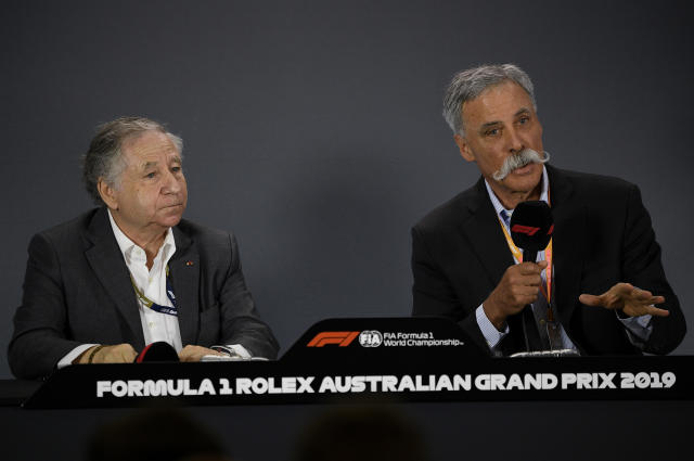 Formula One chairman Chase Carey, right, and FIA boss Jean Todt comment during a press conference after the first practice session of the Australian Grand Prix in Melbourne, Australia, Friday, March 15, 2019. The first race of the year is Sunday. (AP Photo/Andy Brownbill)