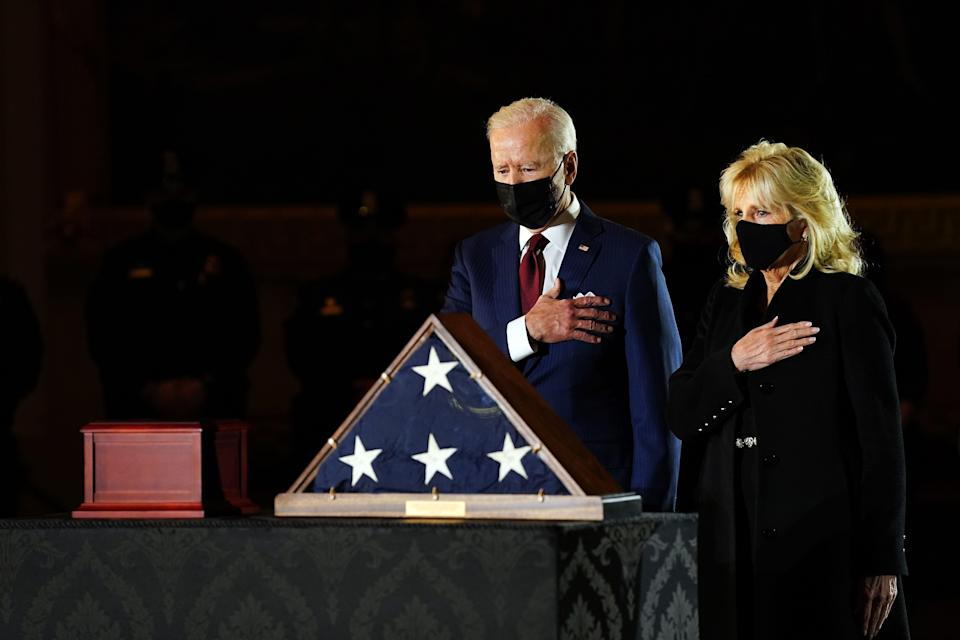 <p>US President Joe Biden and First Lady Jill Biden pay their respects to late US Capitol Police officer Brian Sicknick, as he lies in honor in the Capitol Rotunda in Washington, DC February 2, 2021</p> (Photo by ERIN SCHAFF/POOL/AFP via Getty Images)