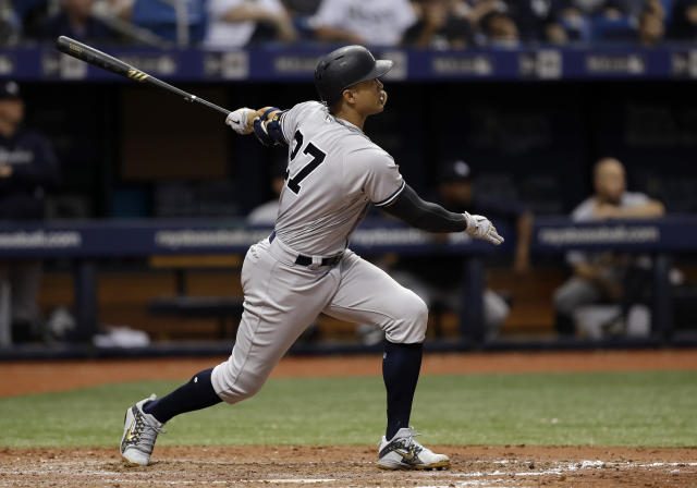 New York Yankees' Giancarlo Stanton watches his home run off Tampa Bay Rays relief pitcher Vidal Nuno during the eighth inning of a baseball game Sunday, June 24, 2018, in St. Petersburg, Fla. (AP Photo/Chris O'Meara)