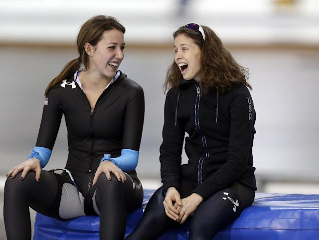 First-place finisher Maria Lamb, right, talks with second-place finisher Petra Acker, left, after competing in the women's 5,000 meters during the U.S. Olympic speedskating trials Wednesday, Jan. 1, 2014, in Kearns, Utah. (AP Photo/Rick Bowmer)