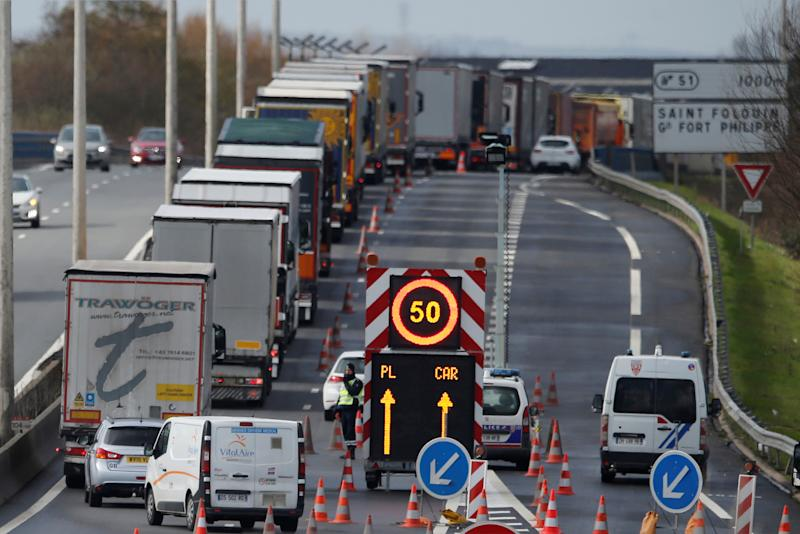 Trucks queue on the Dunkirk-Calais motorway as French Customs Officers increase their controls on transported goods to protest the lack of resources as the Brexit date approaches, in Saint-Folquin, France March 8, 2019. REUTERS/Pascal Rossignol