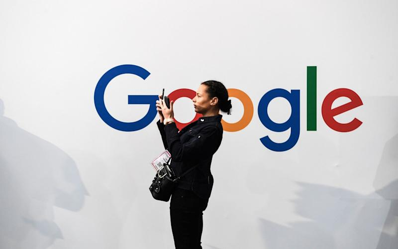The Google founders have been removed from public for several years - AFP