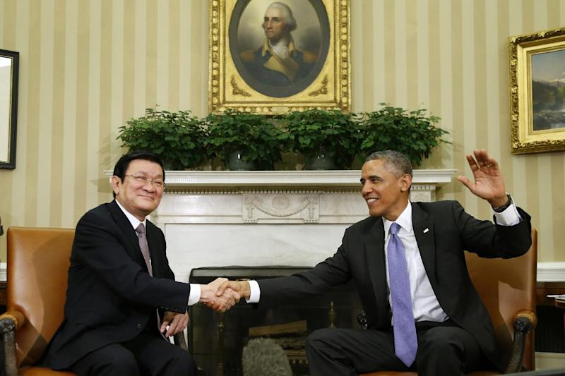 President Barack Obama shakes hands with Vietnam's President Truong Tan Sang during their meeting in the Oval Office at the White House in Washington, Thursday, July 25, 2013. President Barack Obama says he and Vietnamese President Truong Tan Sang are committed to completing a regional trade pact before the end of the year. He said it would create jobs and increase investments in the Asia-Pacific region and in both countries. (AP Photo/Charles Dharapak)