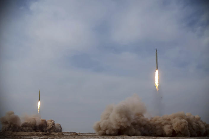 In this photo released on Saturday, Jan. 16, 2021, by the Iranian Revolutionary Guard, missiles are launched in a drill in Iran. Iran's paramilitary Revolutionary Guard conducted a drill Saturday launching anti-warship ballistic missiles at a simulated target in the Indian Ocean, state television reported, amid heightened tensions over Tehran's nuclear program and a U.S. pressure campaign against the Islamic Republic. (Iranian Revolutionary Guard/Sepahnews via AP)